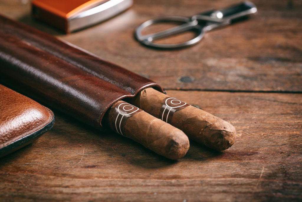Cigars in a leather case.