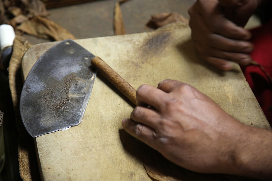 A hand-rolled cigar enters its final stages of production.