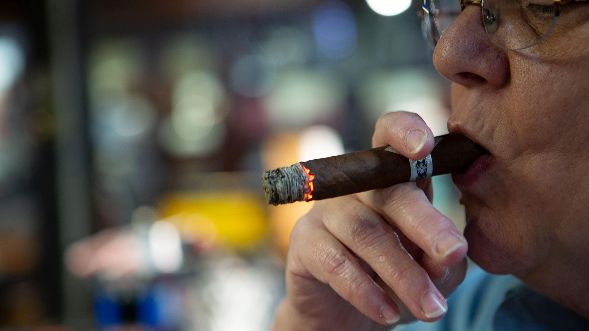 ashing the cigar